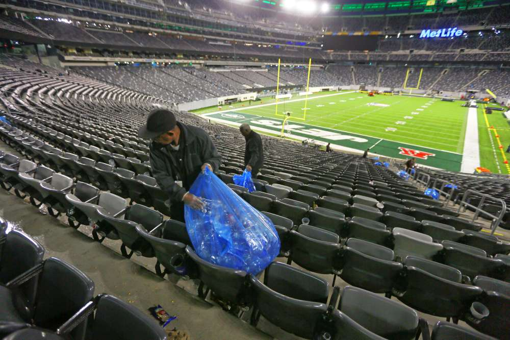 Manuel Tajada cleaning up early Monday after Sunday's Jets game.